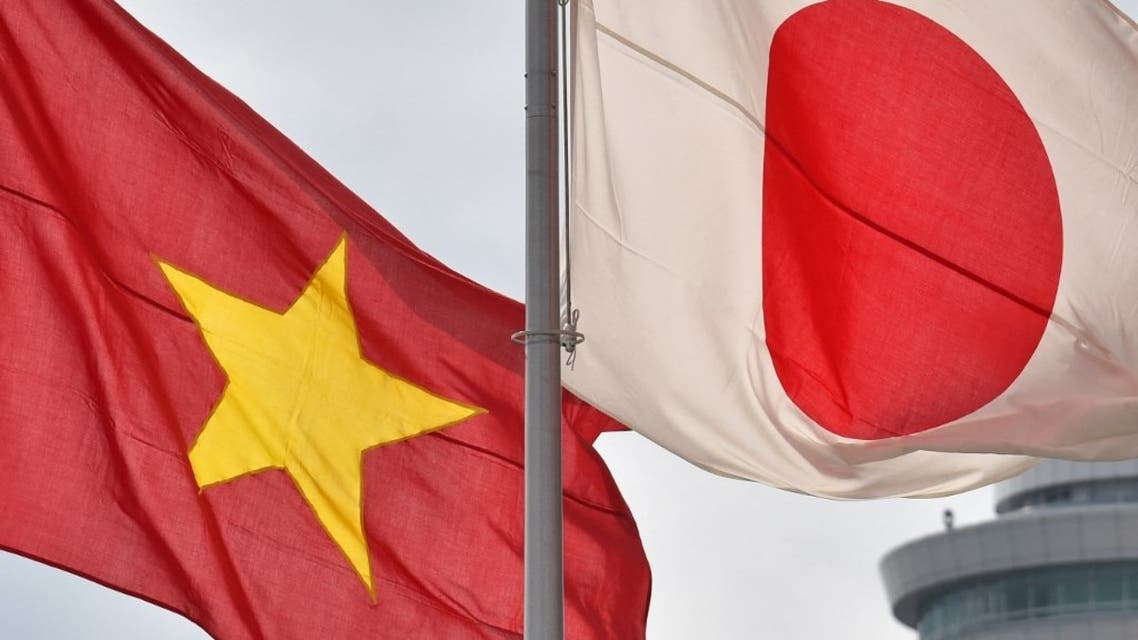 The national flags of Japan (R) and Vietnam are seen at Tokyo's Haneda Airport on February 28, 2017.  (AFP)