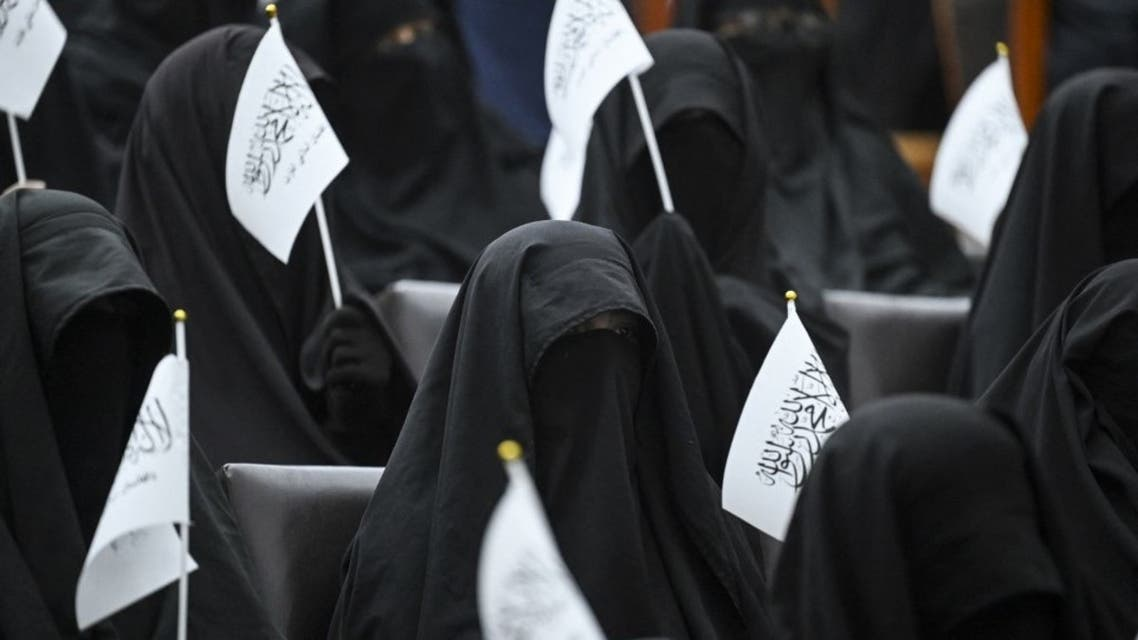 Veiled students hold Taliban flags as they listen a speaker before a pro-Taliban rally at the Shaheed Rabbani Education University in Kabul on September 11, 2021. (AFP)