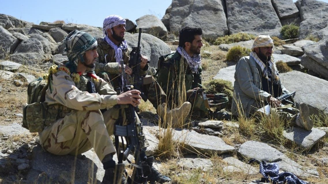 Afghan resistance movement and anti-Taliban uprising forces take rest as they patrol on a hilltop in Darband area in Anaba district, Panjshir province on September 1, 2021. (AFP)