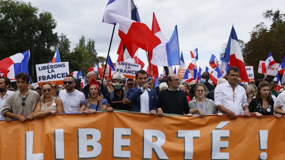 Leader of French nationalist party Les Patriotes (The Patriots) Florian Philippot (C) leads the march during a demonstration against France's Covid-19 health pass in Paris on September 11, 2021. (AFP)