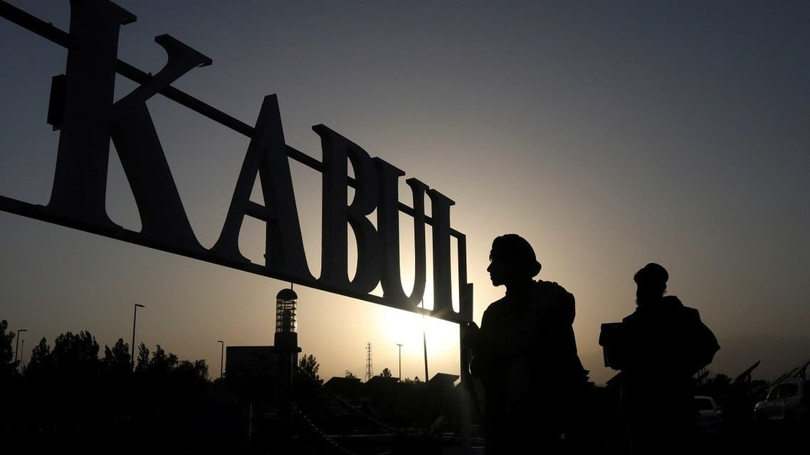 Taliban soldiers stand in front of a sign at the international airport in Kabul, Afghanistan, September 9, 2021. (Reuters)