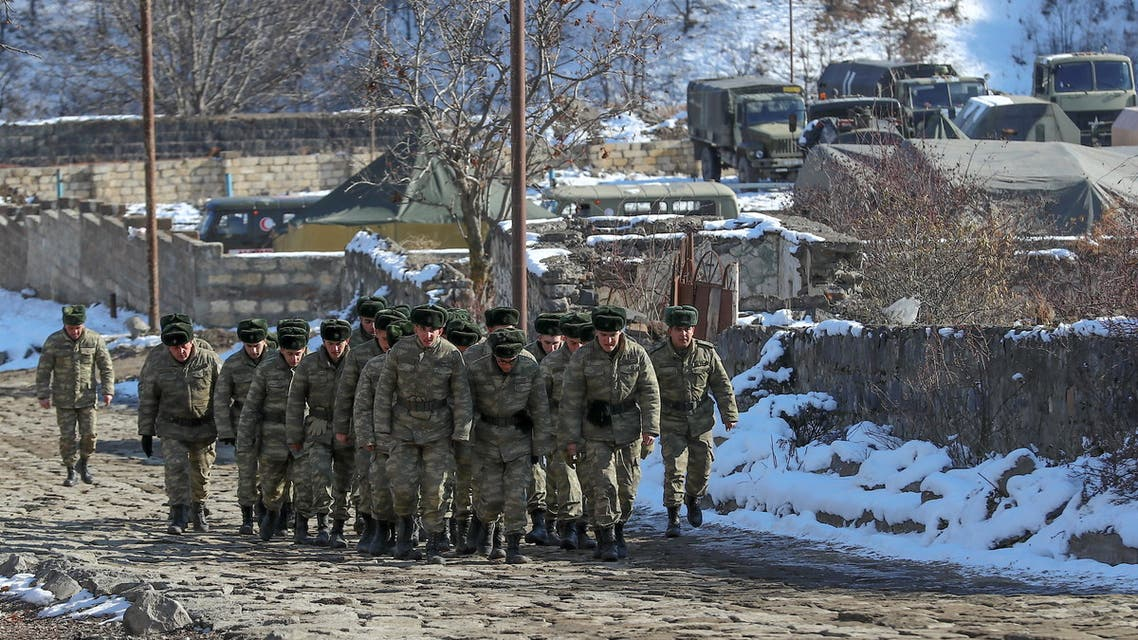 Azeri soldiers walk near their military vehicles at the Kalbajar district, Azerbaijan, December 21, 2020. Picture taken December 21, 2020. (File photo: Reuters)
