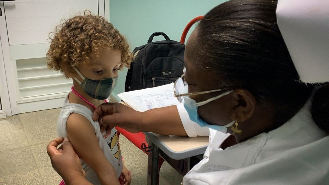 A nurse prepares Roxana Montano, 3, to receive her dose of Soberana Plus, a Cuban vaccine against Covid-19, on August 24, 2021 at Juan Manuel Marquez hospital in Havana. (AFP)