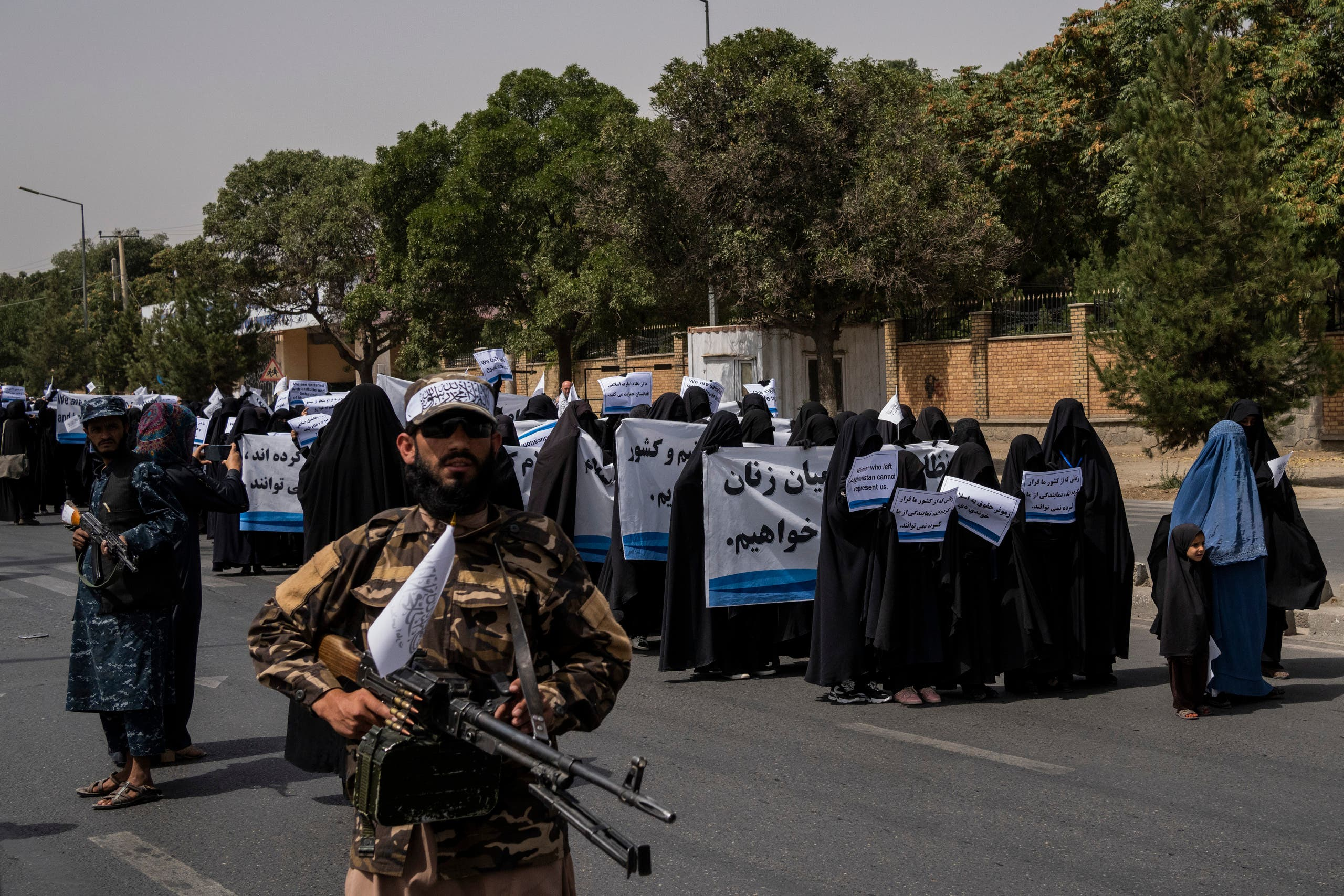 Women march in support of the Taliban government outside Kabul University, Afghanistan, on Saturday, Sept. 11, 2021. (AP)