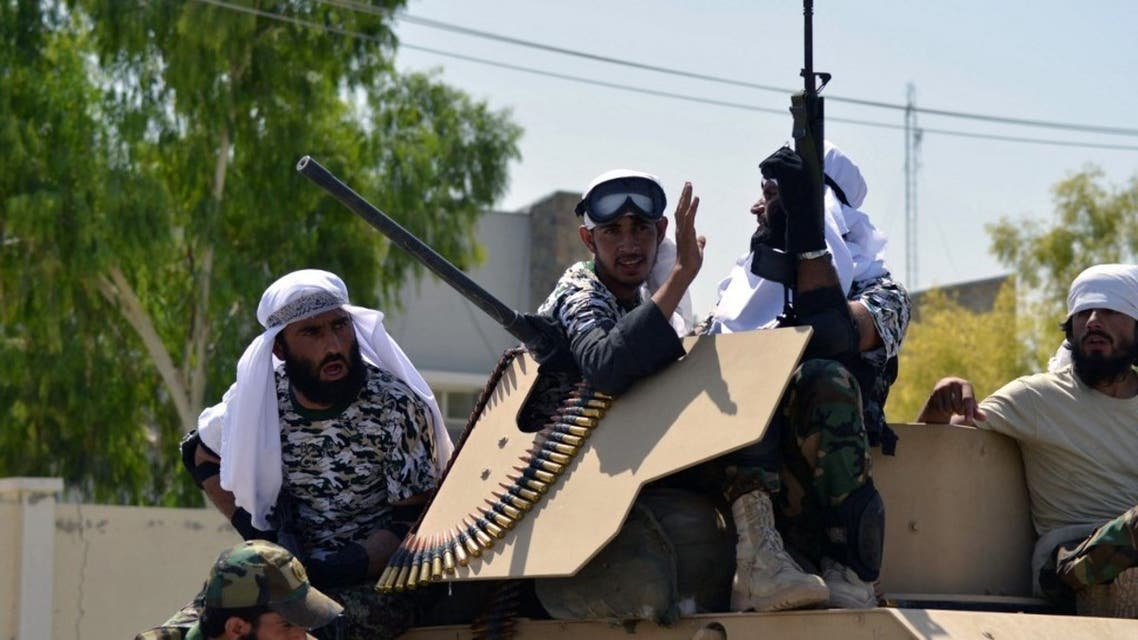 Taliban fighters atop a Humvee vehicle parade along a road to celebrate after the US pulled all its troops out of Afghanistan, in Kandahar on September 1, 2021 following the Taliban's military takeover of the country. (AFP)