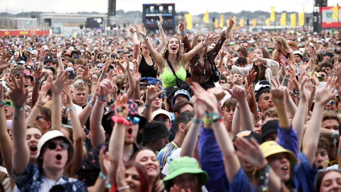 Festival goers watch British band Easy Life perform on the main stage at Reading Festival, in Reading, Britain, August 28, 2021. (File photo: Reuters)