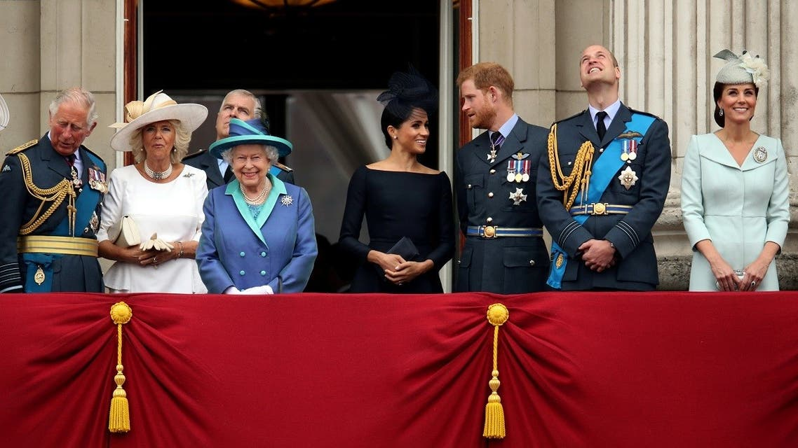 Britain's Queen Elizabeth is joined by members of the Royal Family on the balcony of Buckingham Palace as they watch a fly past to mark the centenary of the Royal Air Force in central London. (Reuters)