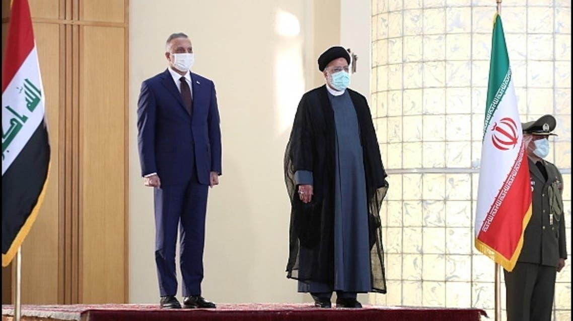 Iran's President Ebrahim Raisi welcomes Iraq's Prime Minister Mustafa al-Kadhimi in Tehran, Iran September 12, 2021. (Official Presidential website/Handout via Reuters)