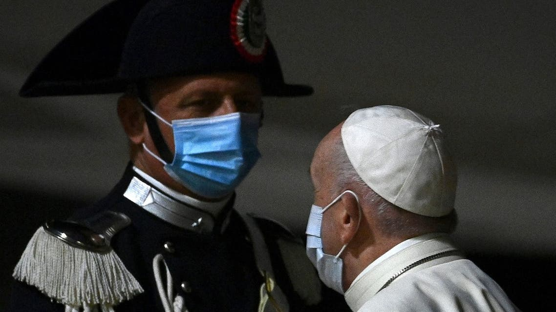 Pope Francis salutes a Carabiniere as he boards a plane for Budapest and Slovakia on September 12, 2021 at Rome's Fiumicino international airport. (AFP)