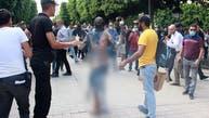 صور قاسية.. تونسي يضرم النار بجسده وسط المارة