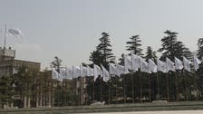 Taliban raise their flag over Afghan presidential palace as US marks 9/11 attacks