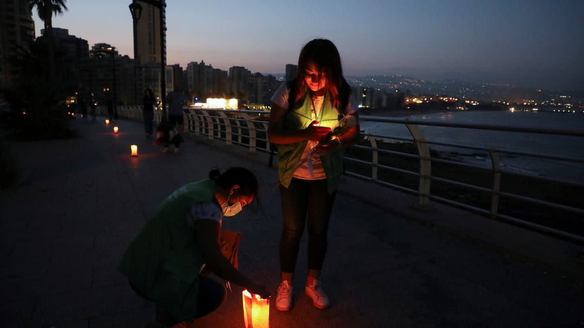 A woman lights a candle during a silent walk at dawn organized by Lebanese non-profit organization Embrace, marking World Suicide Prevention Day, in Beirut, Lebanon September 12, 2021. (File photo: Reuters)