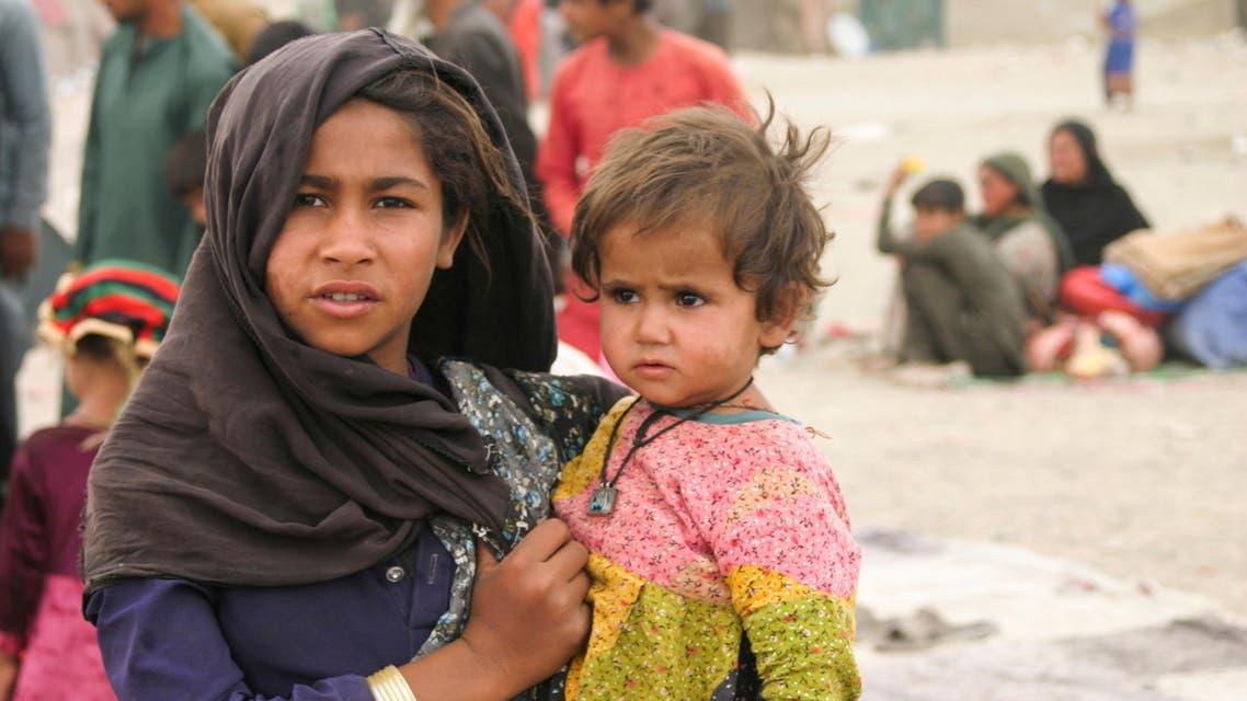 أطفال من أفغانستان (رويترز)