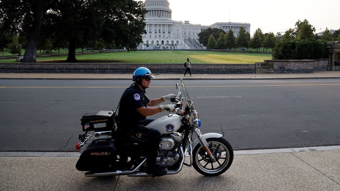 A US Capitol Police officer patrols around the US Capitol in Washington, DC, US September 13, 2021. (Reuters/Jonathan Ernst)