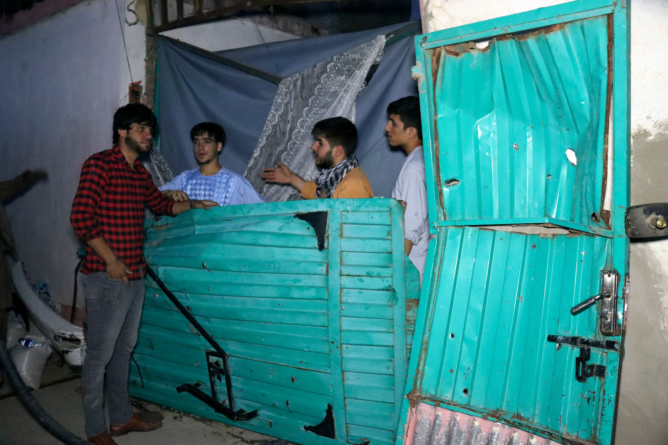 In this Sunday, Aug. 29, 2021 file photo, Afghans inspect damage of Ahmadi family house after U.S. drone strike in Kabul, Afghanistan, Sunday, Aug. 29, 2021. (File photo: AP)
