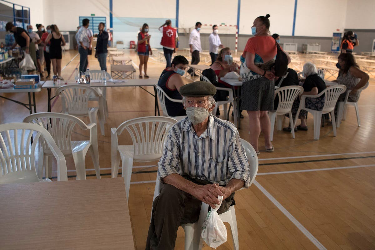 A man from a neighboring town stays at a sports center in Ronda after being evacuated from his home due to a big wildfire in the region, on September 12, 2021. (Jorge Guerrero/AFP)