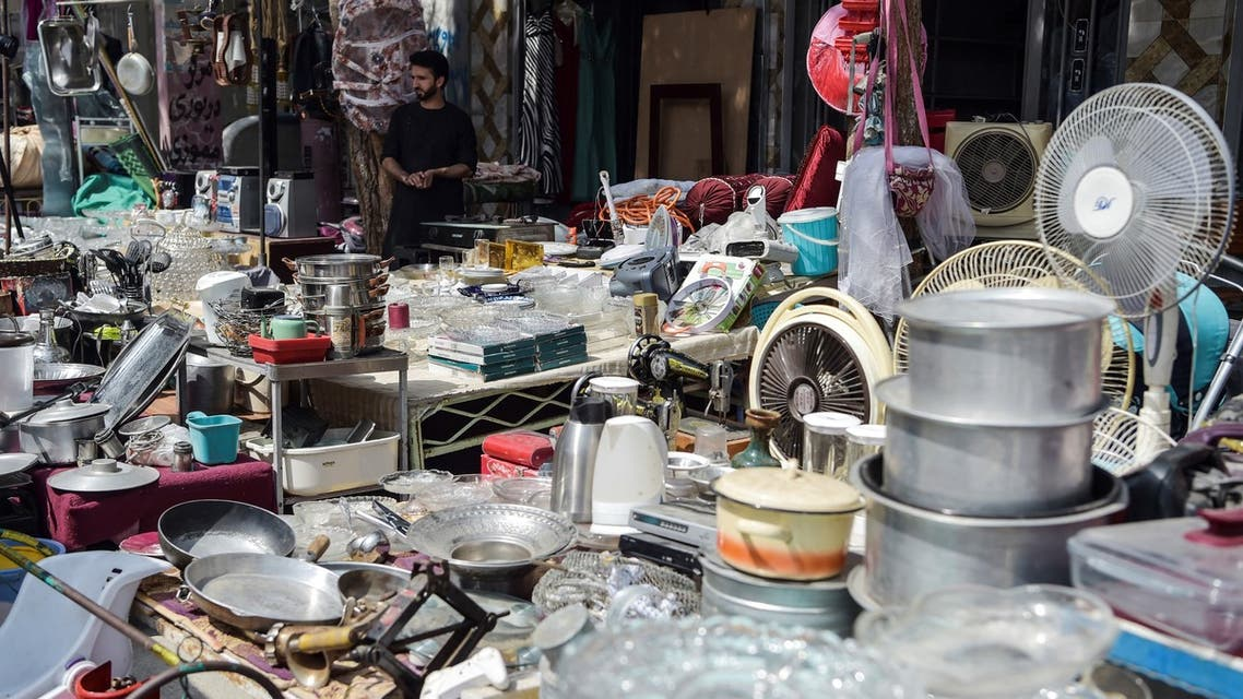 This photo taken on September 12, 2021 shows shopkeepers displaying secondhand household items for sale at a market in the northwest neighbourhood of Khair Khana in Kabul. (AFP)