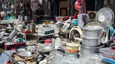 Afghans sell belongings at Kabul bazaars in attempt to fund their escape