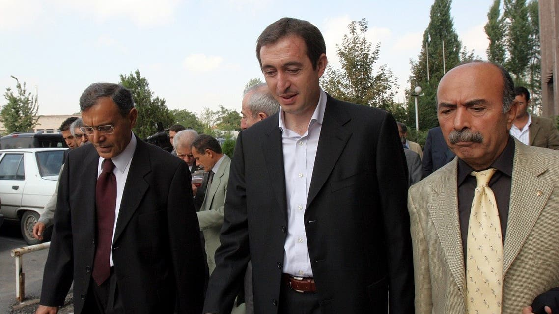 A file photo shows Tuncer Bakirhan, former leader of a now defunct pro-Kurdish People's Democracy Party, or DEHAP, center, and other party members leave a courthouse after their trial in Ankara, Sept. 26, 2006. .(AP/Burhan Ozbilici)