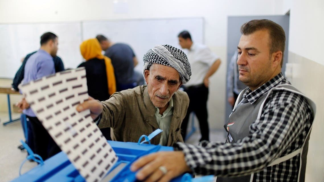 An elderly Kurdish man casts his vote at a polling station, during parliamentary elections in the semi-autonomous region in Erbil. (Reuters)