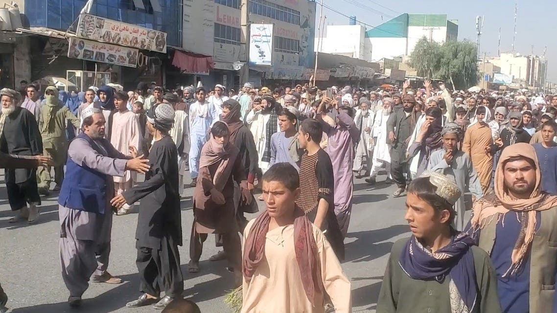 People hold a protest march against the Taliban's decision to force them to leave their homes in Kandahar, Afghanistan September 14, 2021, in this still image taken from video. (ASVAKA News Agency/Handout via Reuters)