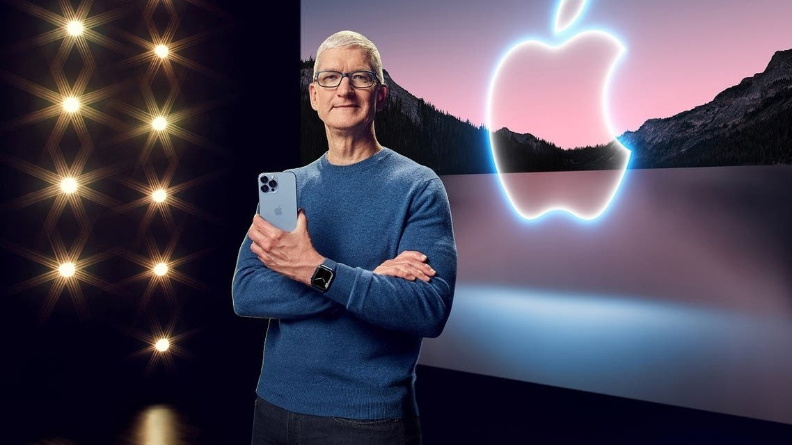 Apple CEO Tim Cook holds the iPhone 13 Pro Max and Apple Watch Series 7 during a special event at Apple Park in Cupertino, California broadcast September 14, 2021. (Apple Inc/Handout via Reuters)