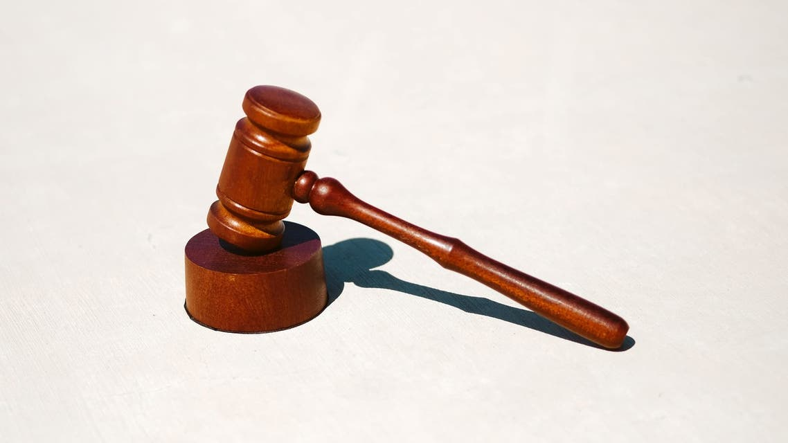 A judge's gavel is pictured on a white surface. court crime hearing judge (Unsplash, Tingey Injury Law Firm)