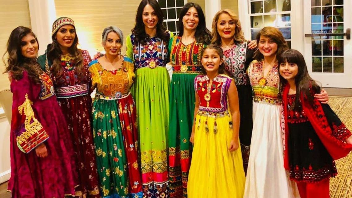 Afghan women share images of themselves dressed in their bright and colorful national attire on social media. (Twitter/DrFatimaKakkar)