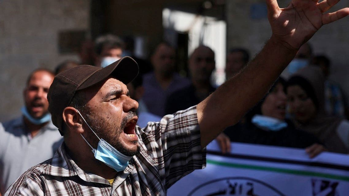 Palestinians chant slogans during a rally next the Red Cross building in Gaza City in support of more than a thousand prisoners who are in Israeli jails, on September 9, 2021. (Mohammed Abed/AFP)