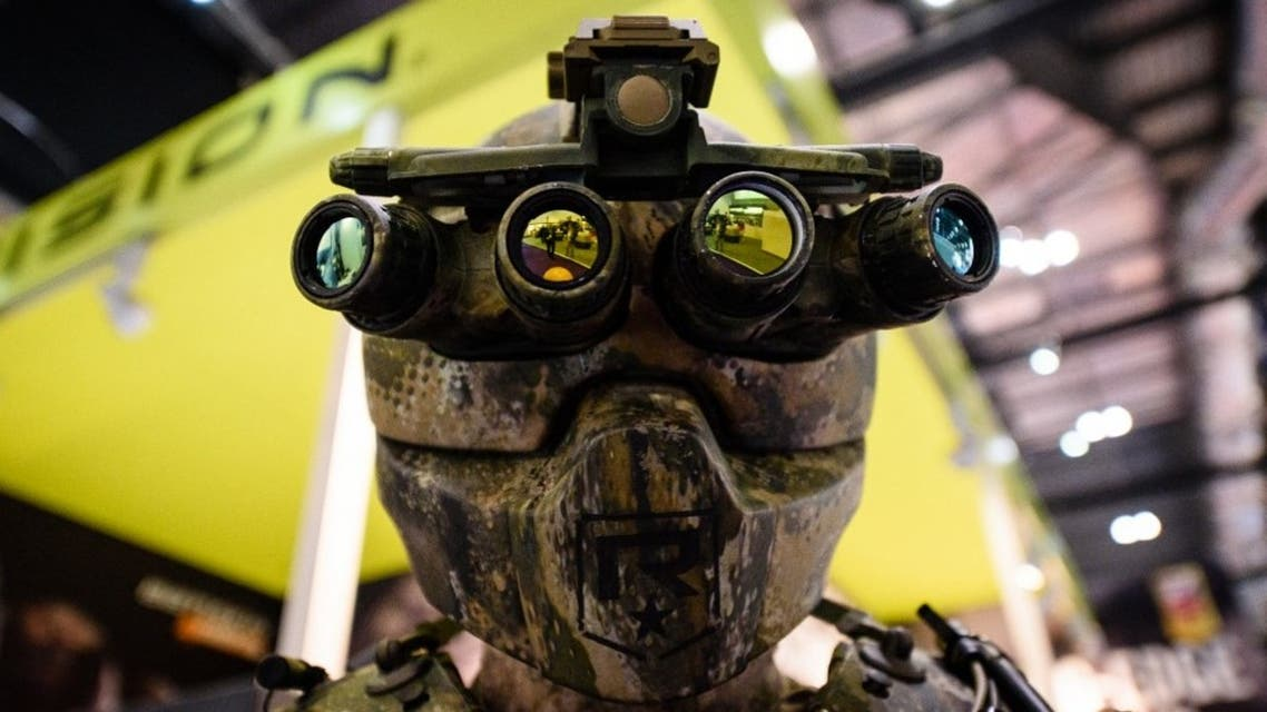 A mannequin wears a Kinetic Operations Suit featuring Quad Optic goggles on the Vision stand inside the ExCeL centre in London on September 15, 2015, during the Defence and Security Equipment International (DSEI) exhibition. (AFP)
