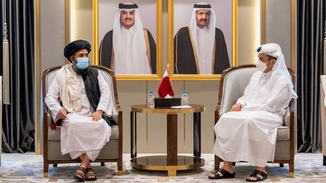 This handout picture provided by Qatar's Ministry of Foreign Affairs on August 17, 2021 shows Qatari Foreign Minister Sheikh Mohammed bin Abdulrahman Al-Thani (R) meeting with the Taliban's political office chief Mullah Abdul Ghani Baradar in Doha.  (AFP)