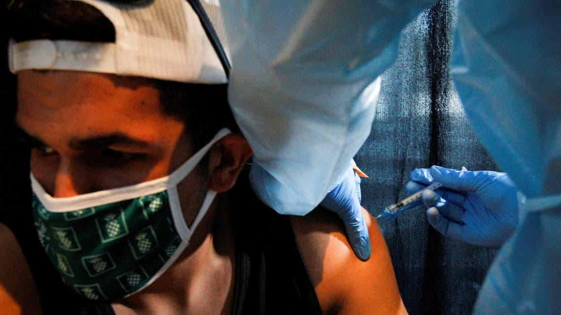 A man is inoculated against the coronavirus disease (COVID-19) during a vaccination event hosted by Miami-Dade County and Miami Heat, at FTX Arena in Miami, Florida, U.S., August 5, 2021. (File photo: Reuters)