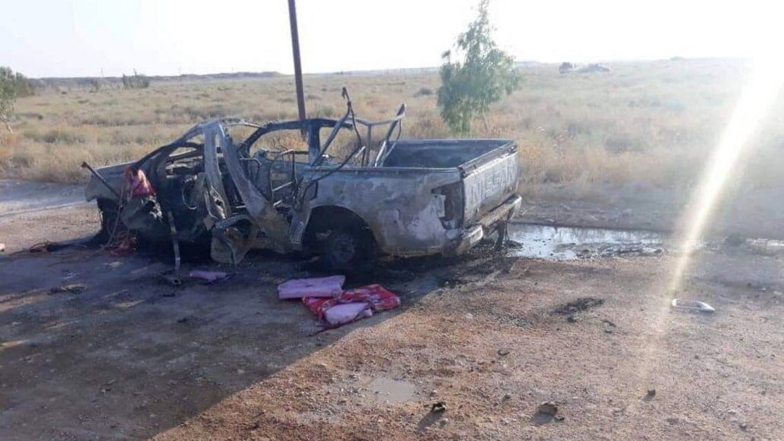 A handout picture released by the Hashed al-Shaabi force shows the wreckage of a vehicle at the site of an unclaimed drone attack near Iraq's western border with Syria on August 25, 2019. (File photo: AFP)
