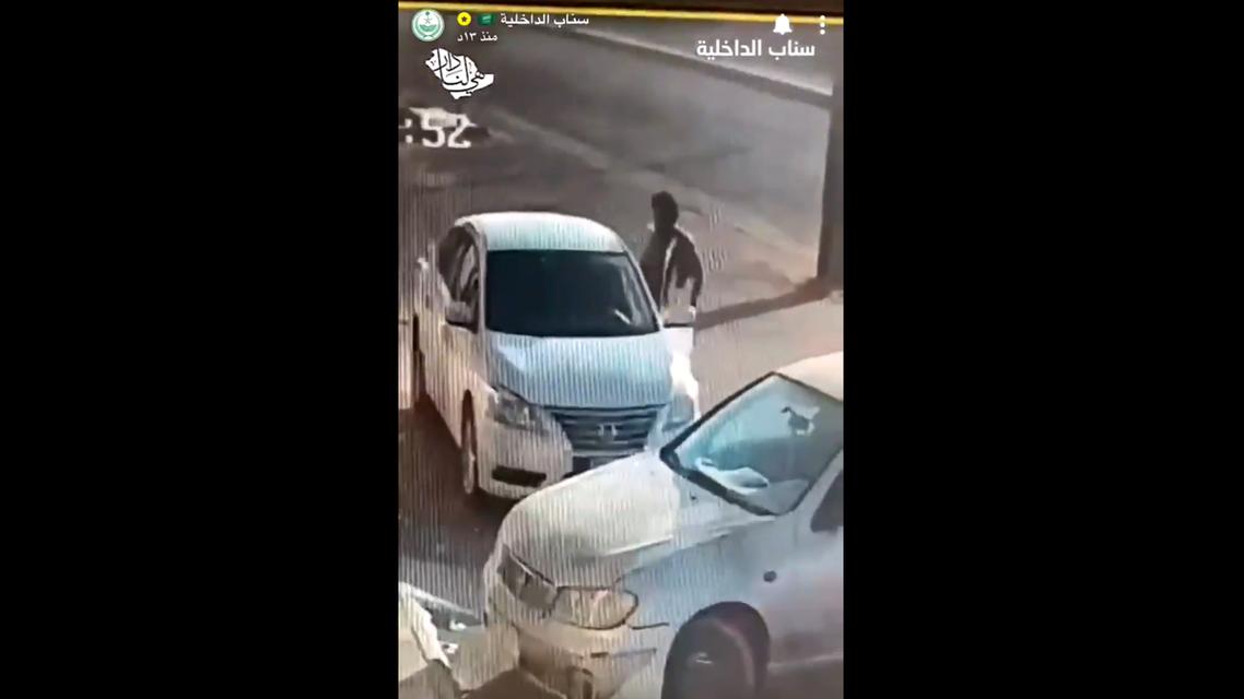 Screengrab of a video that shows a man steeling a car from al-Qassim. (Screengrab)