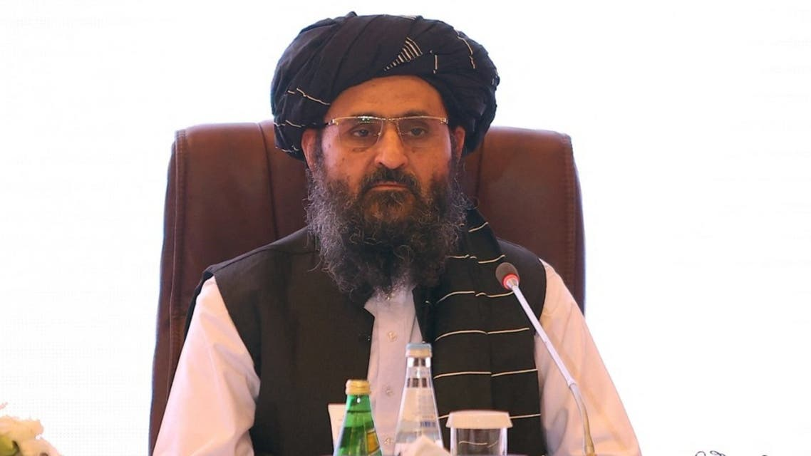 In this file photo taken on July 18, 2021 the leader of the Taliban negotiating team Mullah Abdul Ghani Baradar looks on the final declaration of the peace talks between the Afghan government and the Taliban presented in Qatar's capital Doha. (AFP)