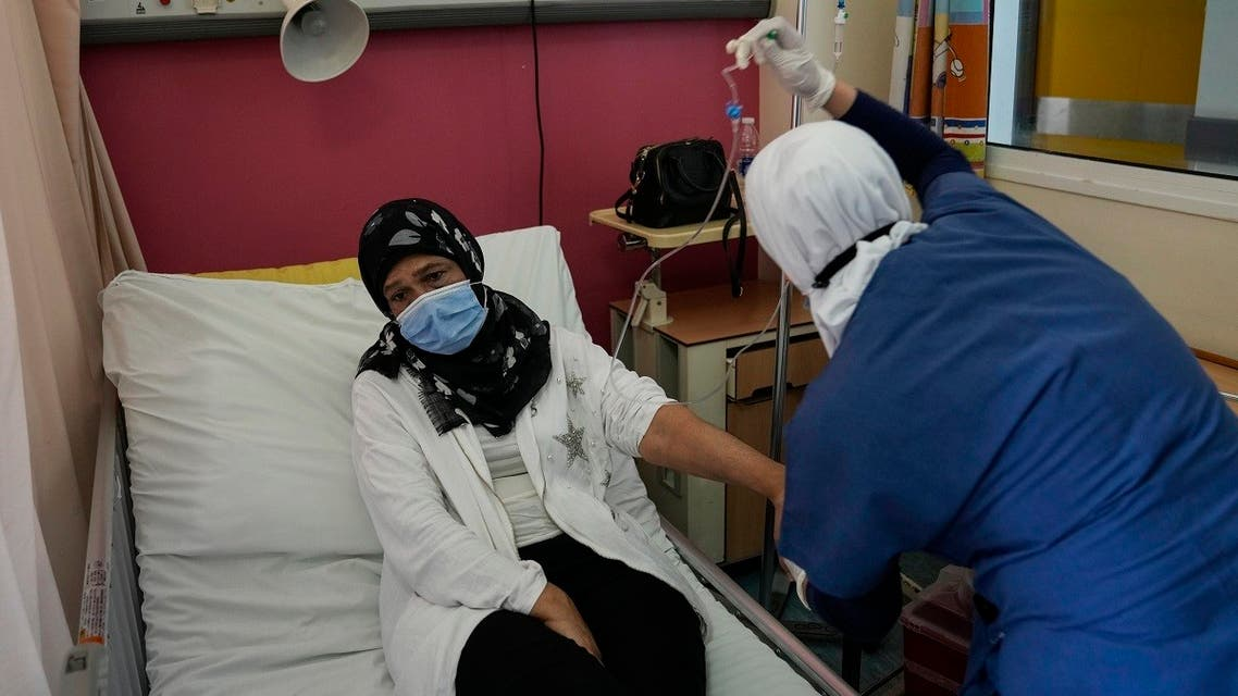 Wahiba Doughan receives chemotherapy treatment for lung cancer at the government-run Rafik Hariri University Hospital in Beirut, Lebanon, Wednesday, Sept. 8, 2021. (AP/Hassan Ammar)