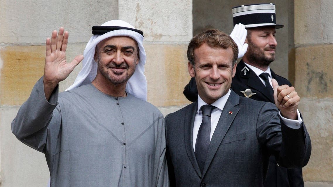 French President Emmanuel Macron (R) poses with Abu Dhabi Crown Prince Mohammed bin Zayed (L) upon their arrival at the Fontainebleau's castle in Fontainebleau, on September 15, 2021, ahead of their working lunch. (Stefano Rellandini/AFP)