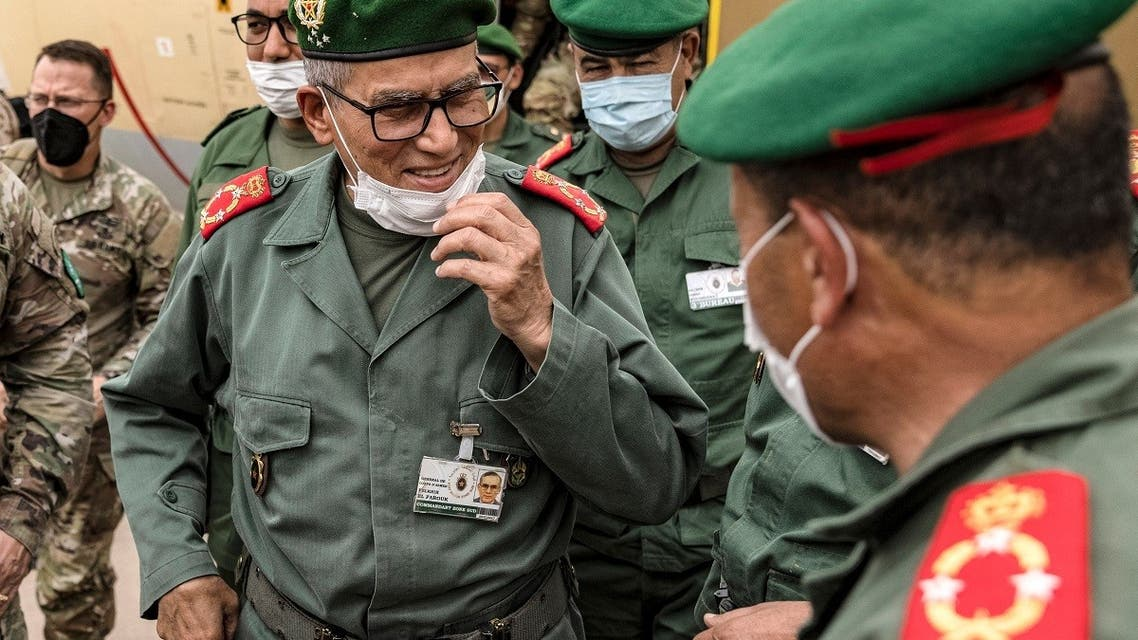 In this file photo taken on June 9, 2021, Morocco's Division General Belkhir el-Farouk (L), greets officers as he arrives to attend the African Lion military exercise at Grier Labouihi military airport in southeastern Morocco. (AFP)