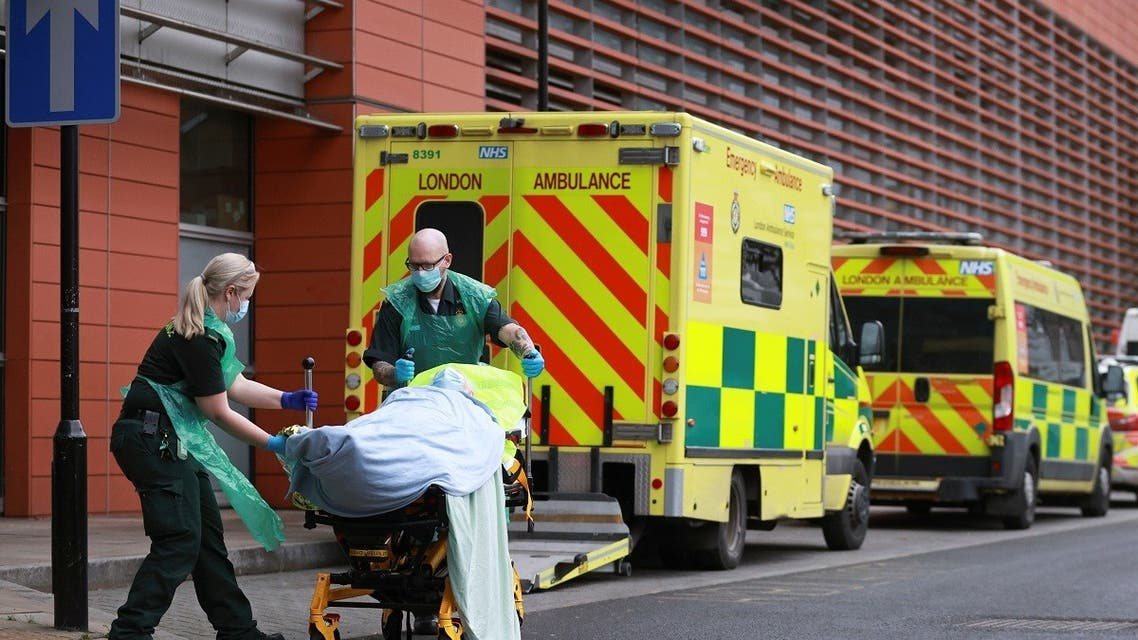 Healthcare workers transport a patient at the Royal London Hospital, as the spread of the coronavirus disease (COVID-19) continues, in London, Britain, January 26, 2021. (Reuters)