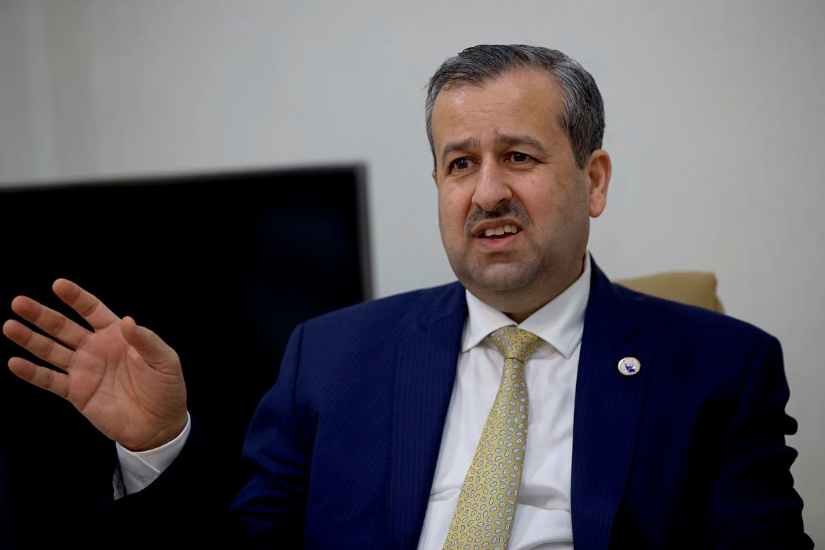 Judge Jaleel Adnan Khalaf, chairman of the Iraqi Independent High Electoral Commission, speaks during an interview with The Associated Press, Tuesday, Sept. 14, 2021, in Baghdad, Iraq. (AP)