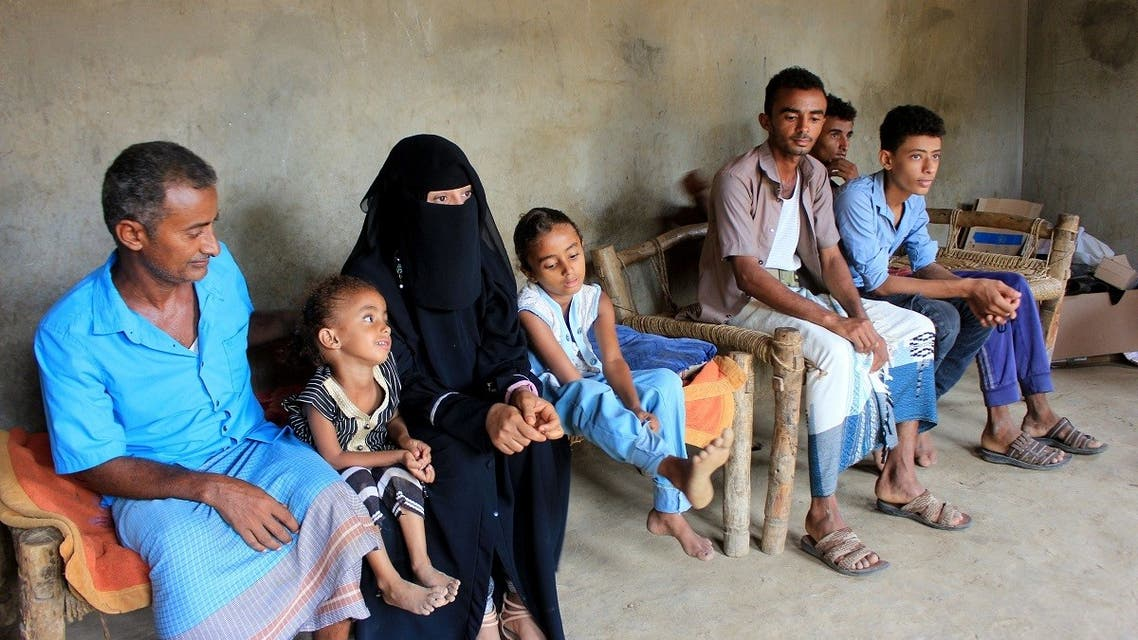 Volunteer health worker Ashwaq Mahmoud sits with her father and other family members at their home in Abs, Yemen September 13, 2021. Picture taken September 13, 2021. (Reuters)