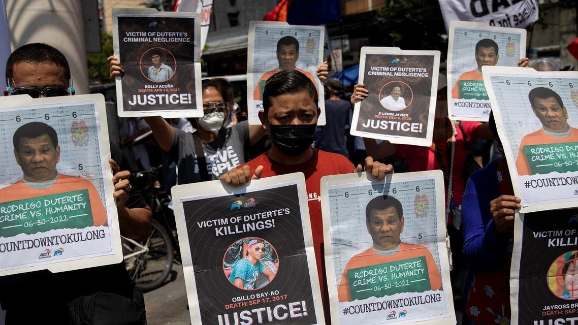 Protesters hold photographs of alleged extra-judicial killings victims and mock mugshots of President Rodrigo Duterte, during a protest to commemorate Duterte's final year in office, in Manila, Philippines, June 30, 2021. (Reuters)