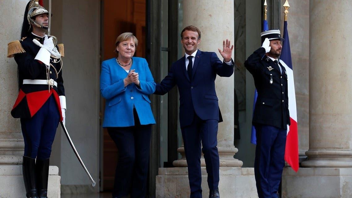 French President Emmanuel Macron welcomes German Chancellor Angela Merkel in Paris, Sept. 16, 2021. (Reuters)