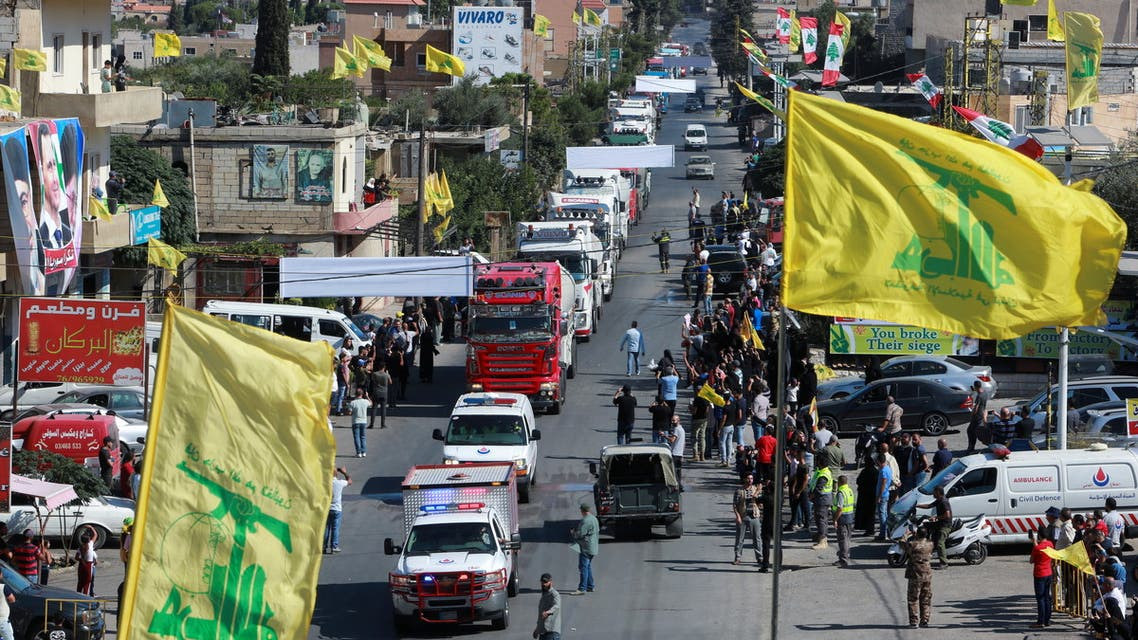 Hezbollah flags flutter as a convoy of tanker trucks carrying Iranian fuel oil arrive at al-Ain village in northeastern Lebanon, September 16, 2021. (Reuters)