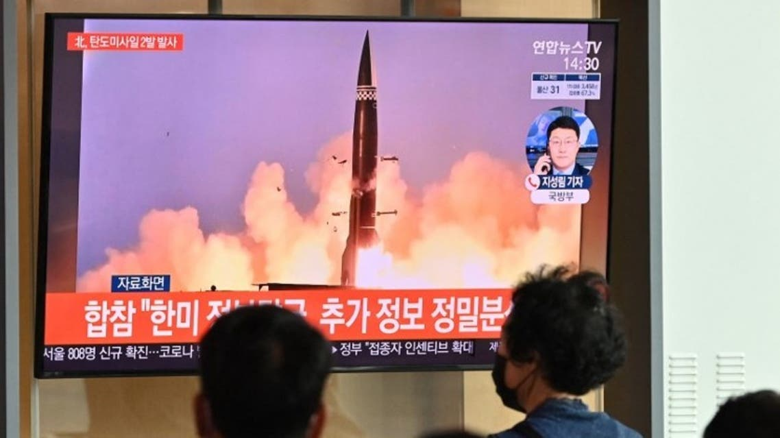 People watch a television news broadcast showing file footage of a North Korean missile test, at a railway station in Seoul on September 15, 2021. (AFP)