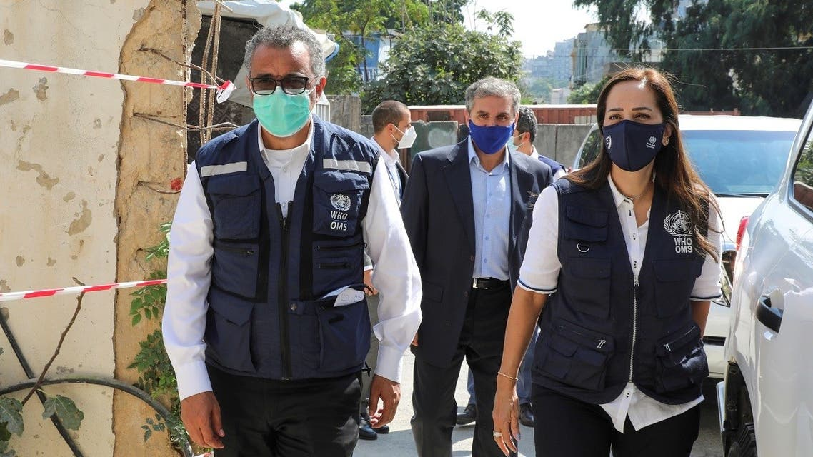 WHO Director-General Tedros Adhanom Ghebreyesus walks with Iman Shankiti, WHO representative in Lebanon, as they arrive at a drug warehouse in Beirut, Sept. 17, 2021. (Reuters)