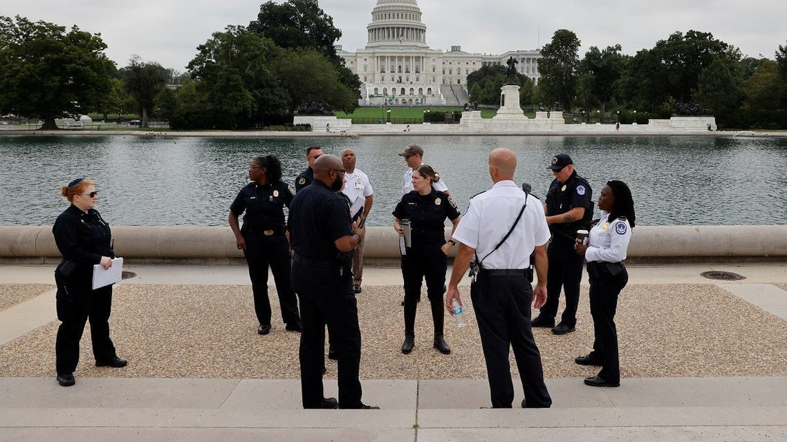 US Capitol Police officials survey the area around the Capitol reflecting pool ahead of an expected rally Saturday in support of the Jan. 6 defendants in Washington, US September 16, 2021. (Reuters/Jonathan Ernst)
