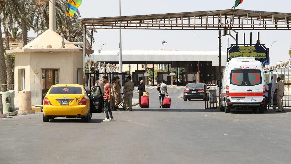 A picture taken on September 17, 2021, shows cars queuing to cross into Tunisia through the Libyan Ras Jdeir border crossing. (Mahmud Turkia/AFP)