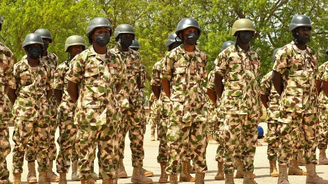 Soldiers stand on guard during Nigerian President Muhammadu Buhari's visit to the Maimalari Barracks in Maiduguri on June 17, 2021. (AFP)