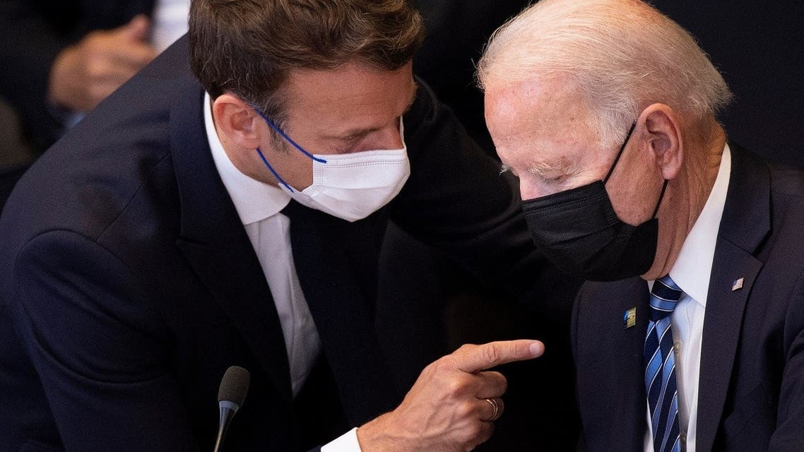 France's President Emmanuel Macron (L) talks to US President Joe Biden at the NATO headquarters in Brussels on June 14, 2021. (AFP)